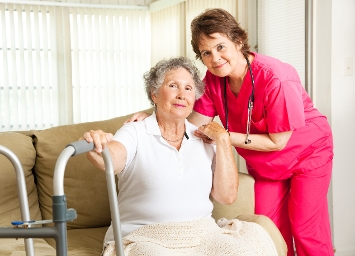 Lady in care home with nurse