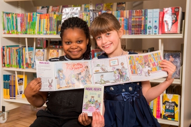 2017 - Children in a library holding up reading records for the Summer Reading Challenge