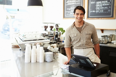 STOCK IMAGE - Coffee shop owner