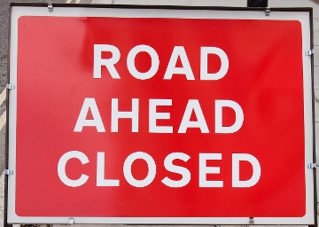 Image of a road ahead closed traffic sign