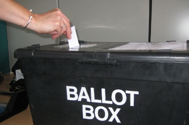 Ballot paper being put in ballot box