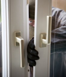 STOCK IMAGE - Burglar at the window