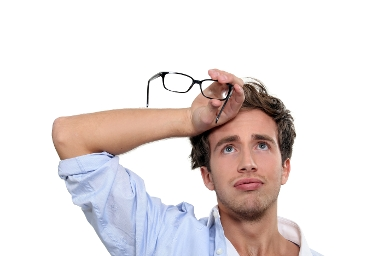 STOCK IMAGE - Tired man with glasses