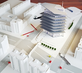 An image showing an architectural model of a modern building.