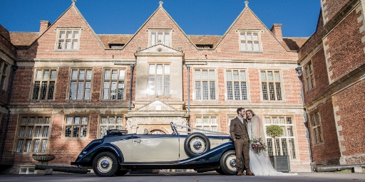 Shaw House Weddings - couple stood outside house with vintage car