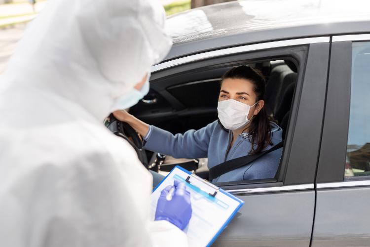 Woman in car doing Covid-19 test
