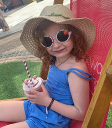 2020 - young girl smiling in the sunshine with a drink (used for heatwave alert)