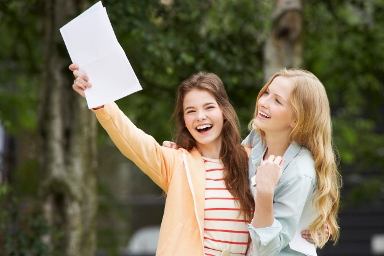 STOCK IMAGE: Two girls celebrate GCSE result