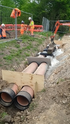Floral Way - Laying of pipe on ditch across the new access road